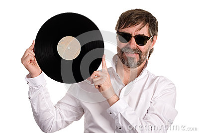 Music lover with an old vinyl disc