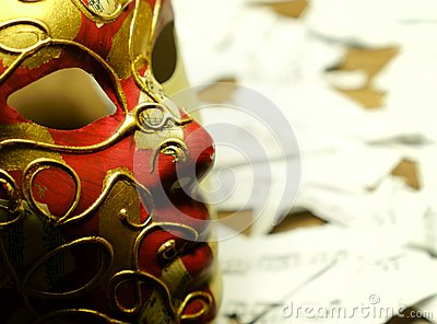 Music notes on golden and red carnival mask and teared paper mus Stock Photo