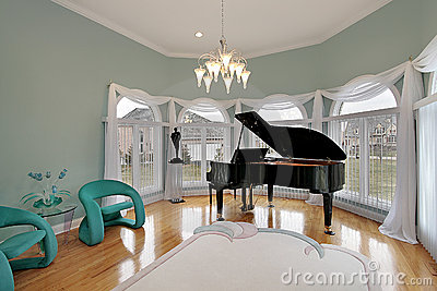 Music room with green chairs