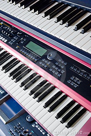 music synthesizer keyboards on rack