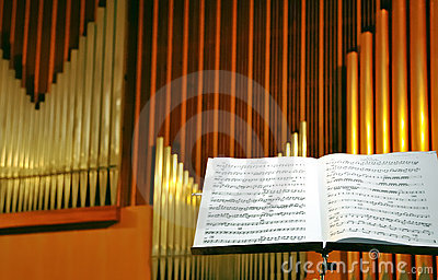 Musical page with organ pipes
