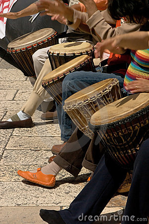 Musicants playing drums during street concert