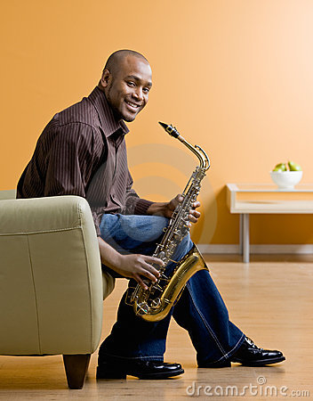 Musician holding saxophone