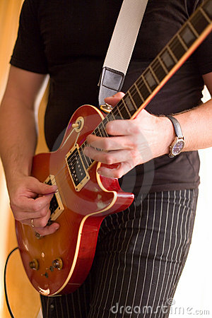 Musician play on guitar #1