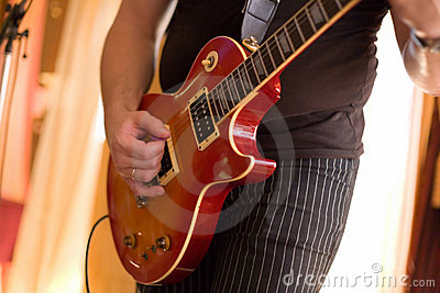 Musician play on guitar #2