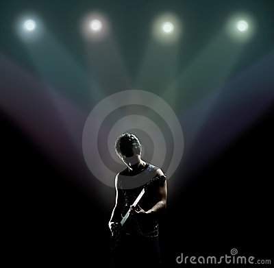 Musician playing the guitar on the stage