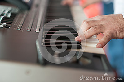 Musician playing on keyboards