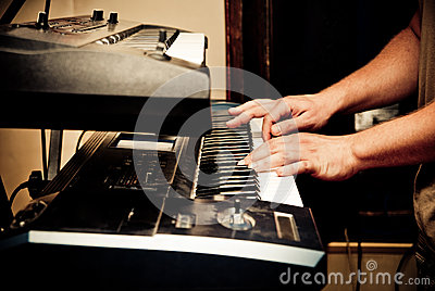 Musician playing synthesizer