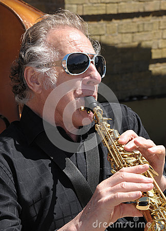 A musician plays Editorial Stock Photo
