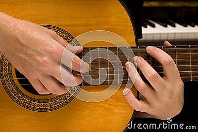 Musician plays a musical instrument,guitarist