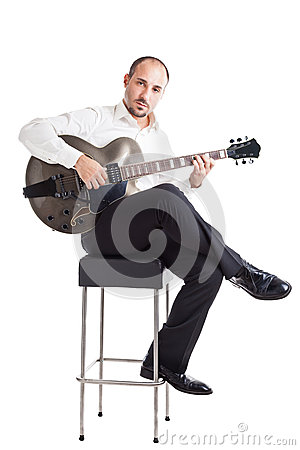Musician on a stool