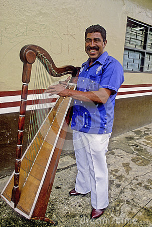 Musician from Veracruz with harp Editorial Photo