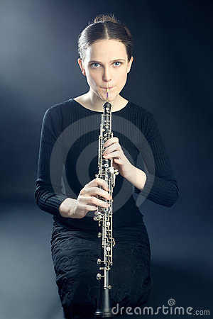 Musician woman playing oboe musical instrument