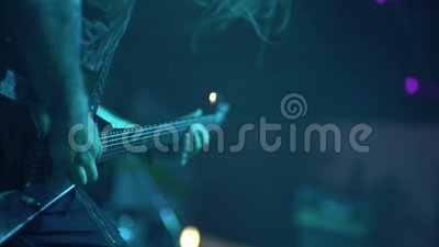 The musicians play on a vintage electric guitar at the rock music festival. hands close-up. The musicians play on a vintage electric guitar at the rock music stock video footage