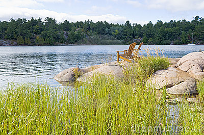 Muskoka Chairs On a Big Rock