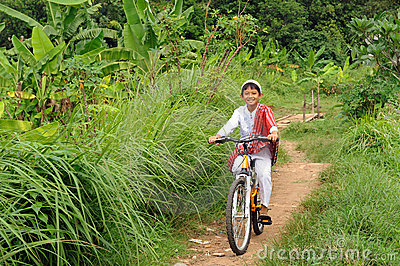 Muslim Boy Riding Bicycle