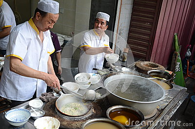 Muslim chinese cooking men Editorial Stock Image