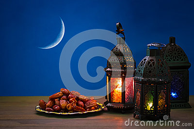 The Muslim feast of the holy month of Ramadan Kareem. Beautiful background with a shining lantern Fanus Stock Photo