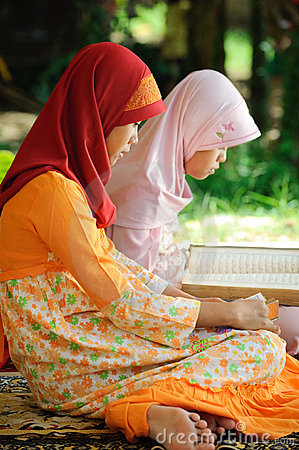 Muslim Female Reading Koran
