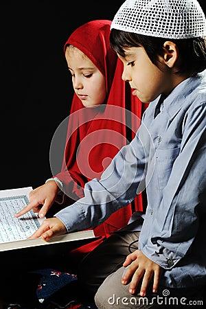 Muslim girl and boy on black background