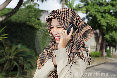 Muslim girl calling by cellphone