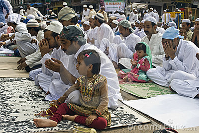 A Muslim Girl at Eid prayer Editorial Stock Photo