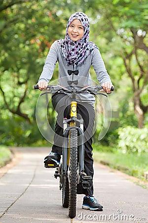 Free Muslim Girl On Bicycle Stock Photo - 38359160