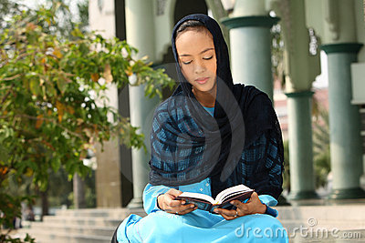 Muslim Girl Reading Qur an