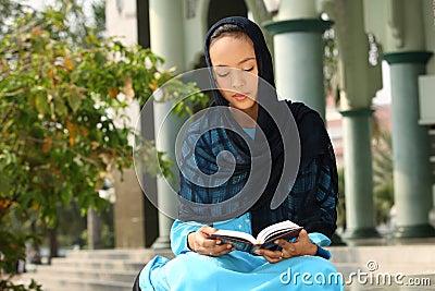 Muslim Girl Reading Qur'an