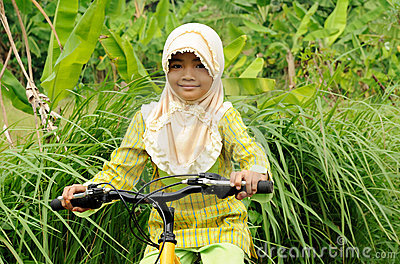 Muslim Girl Riding Bicycle