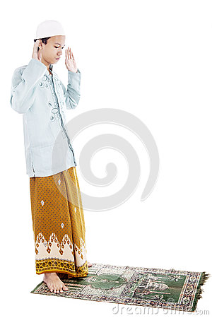 Muslim man praying on mat