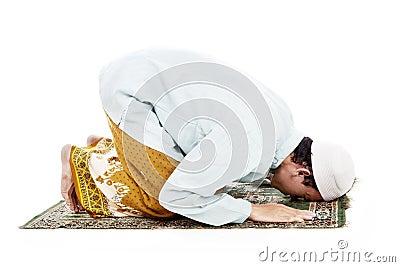 Muslim man prostrating in praying