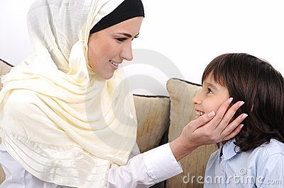 Muslim mother and son relaxing