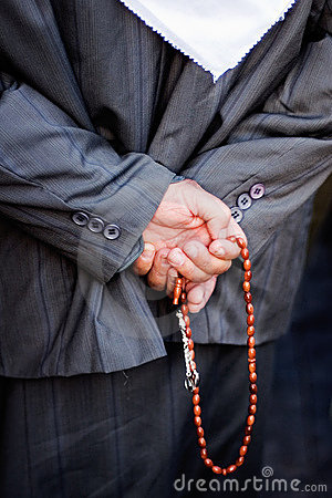 Muslim with prayer beads