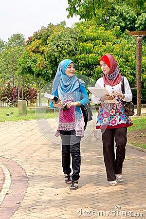 Muslim woman carrying books