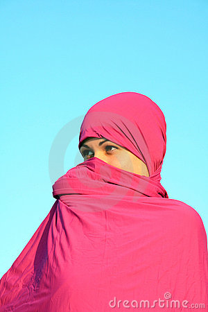 Muslim woman hiding behind scarf