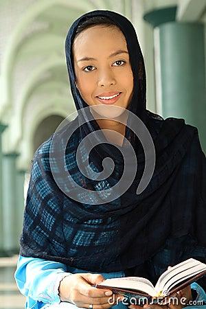 Muslim Woman Holding Qur an
