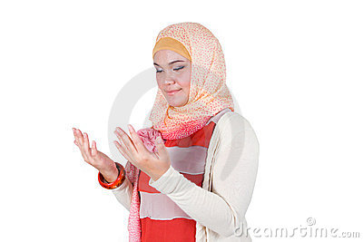 A muslim woman praying.