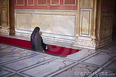 Muslim woman in sari kneeling and praying at the m Editorial Stock Photo