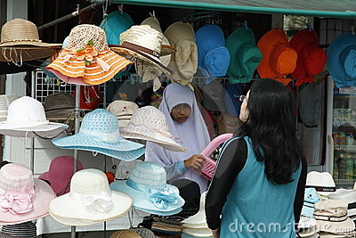 Muslim woman selling hats Editorial Photo