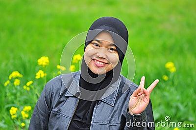A muslim woman smiles in spring season