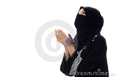 A muslim women pray looking up from side wide