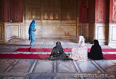 Muslim women praying at the islamic mosque Editorial Stock Photo
