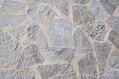 Muur met gespannen rotsenachtergrond