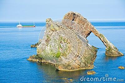 MV Scot Explorer sails past the Bowfiddle rock. Editorial Photography