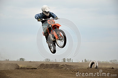 MX racer on a jumping from a hill Editorial Image