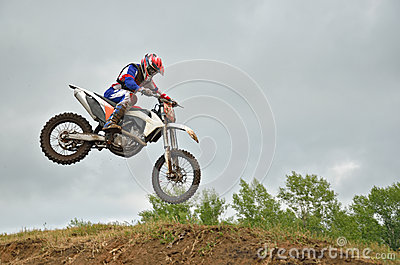 MX racer lands on the front wheel