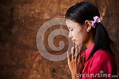 Myanmar girl in a praying pose.