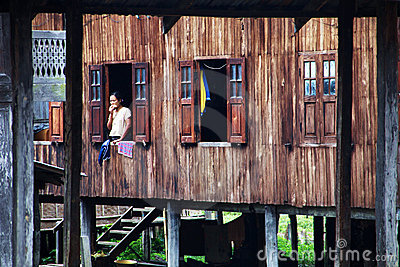 Myanmar woman at the window Editorial Stock Photo