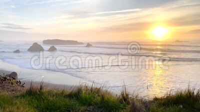Myers Creek Beach. Sunset from Myers Creek beach, Oregon with beautiful color in the sky reflecting on the waves stock video footage
